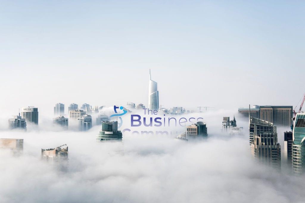 Logo 'teaser image' showing logo partially rising above a cloudy cityscape